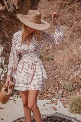 Polka dot linen dress Dubai and UK with long sleeves short length mini dress by Palm Collective